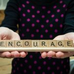 Scrabble Tiles with the word 'Encourage'