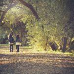 Two Children Walking Through Woods