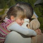 Daughter hugging her father