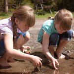 Girls exploring at river