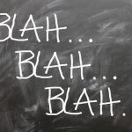 blackboard with words 'blah blah blah...'