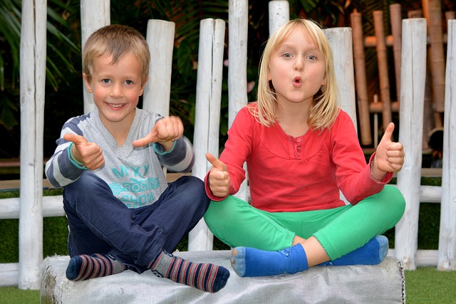 Boy and Girl showing thumbs up