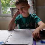 Boy Overwhelmed by Homework
