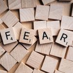 Scrabble pieces spelling FEAR