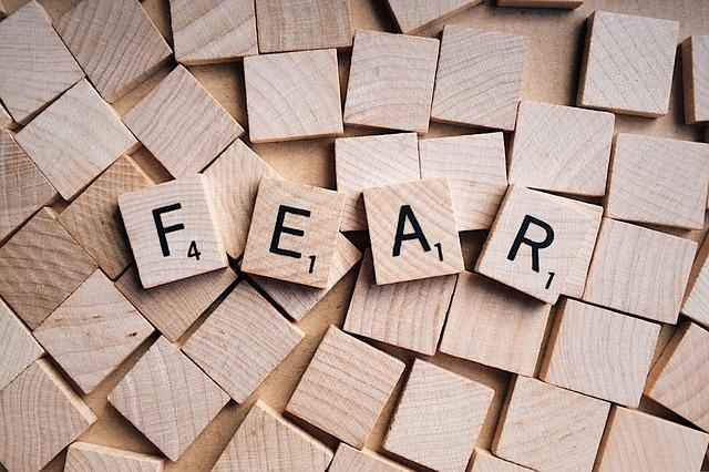 Scrabble pieces spelling FEAR