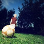 Child alone with football