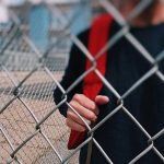 Boy outside school gates