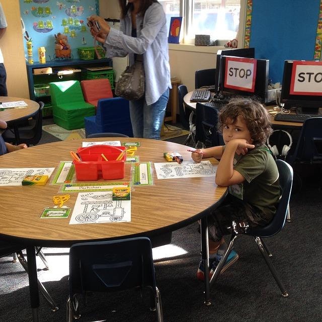 child sitting at desk in school