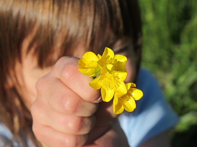 Girl giving yellow flowers