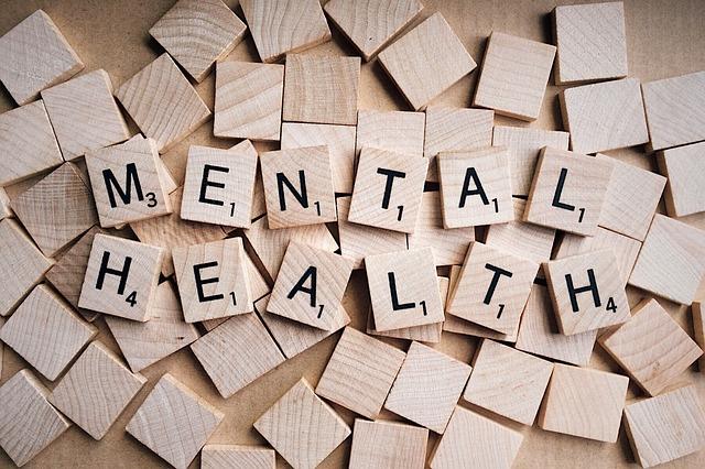 scrabble tiles spelling the words 'mental health'