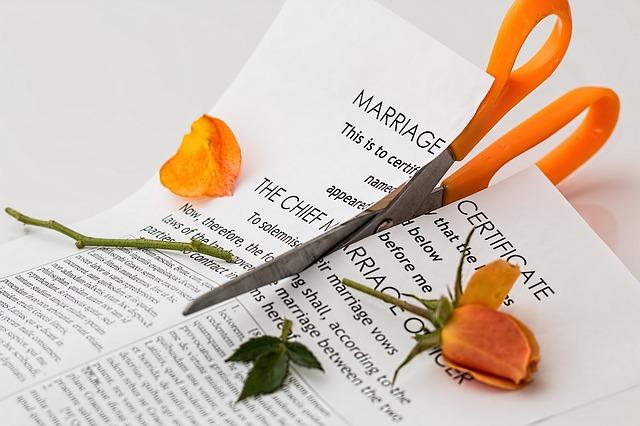Wedding certificate being cut in half