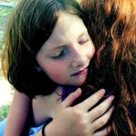 girls hugging - making up and solving problems