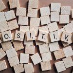 Positive Written in Scrabble Tiles