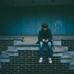 Boy Sitting Alone