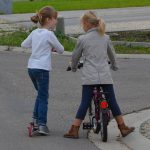 2 young girls talking on the street