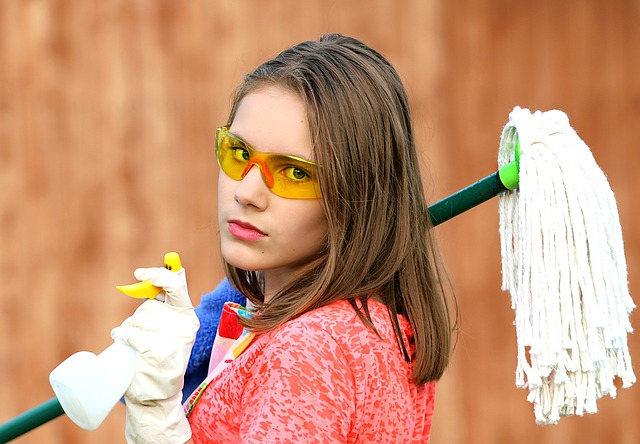 Girl with Mop and cleaning spray