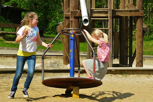2 girls playing in playground