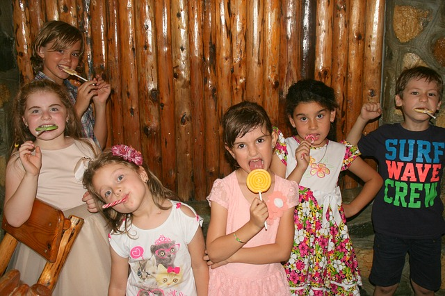 Children in a gang eating candy