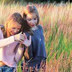 2 teen girls in a meadow