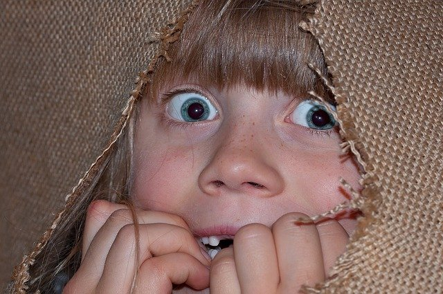 Little Girl looking scared and negative