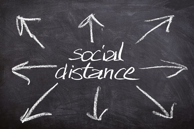 the words 'social distance' on a chalkboard