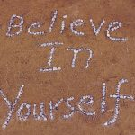 Shells in Sand spelling out'believe in yourself'