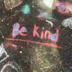 """Words """"Be Kind"""" written in chalk on floor"""