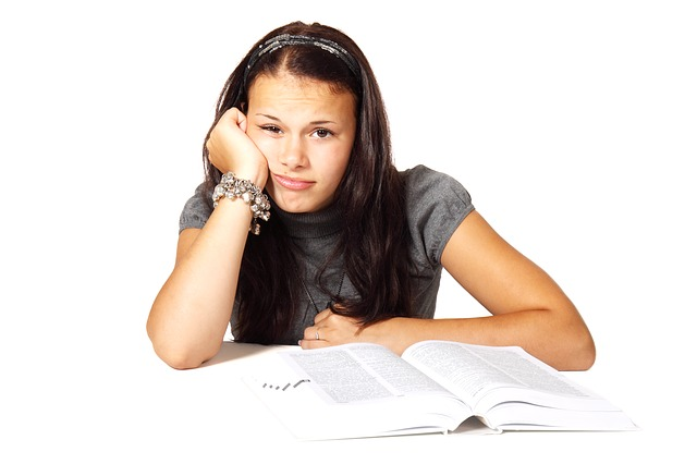 Girl with book looking bored