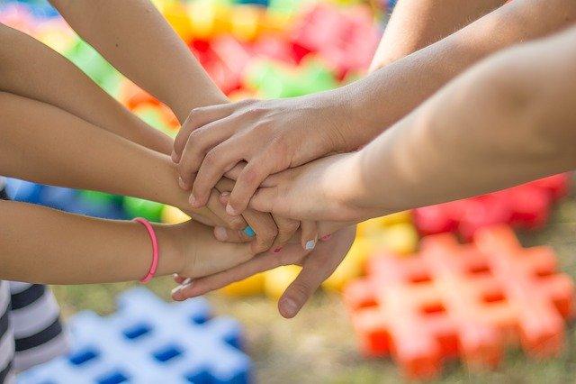 6 hands in group handshake