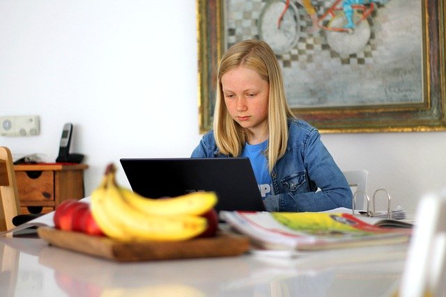 Girl studying alone on kitchen table