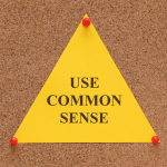 pin board with 'use common sense' note on it