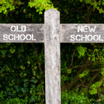 sign with arrows pointing to old school and new school