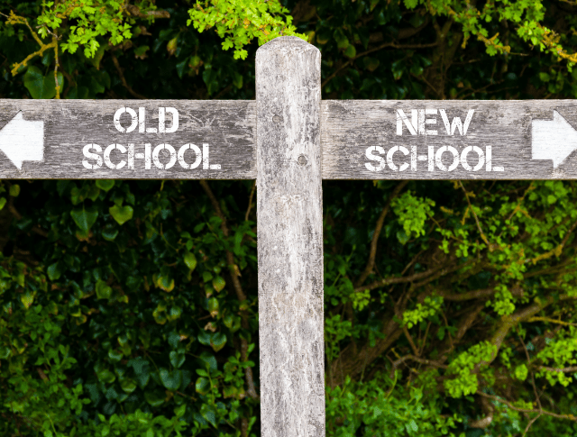 signpost with arrows pointing to old school and new school