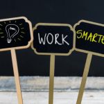 WORK SMARTER and lightbulb symbol written on three small blackboards
